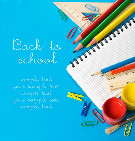 secondary school: School stationery on the blue with copy space