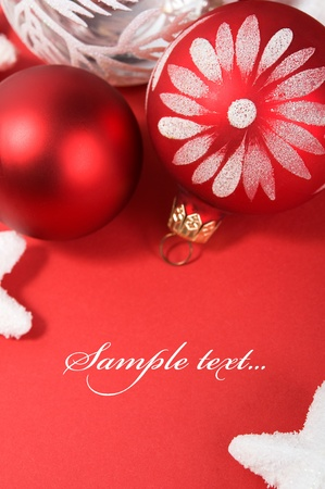 Xmas decoration on the red with copy space. Vertical composition. photo