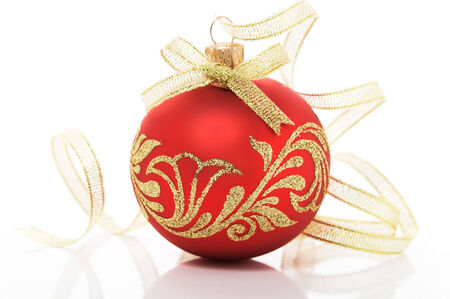 Red xmas ball and golden ribbon on the white