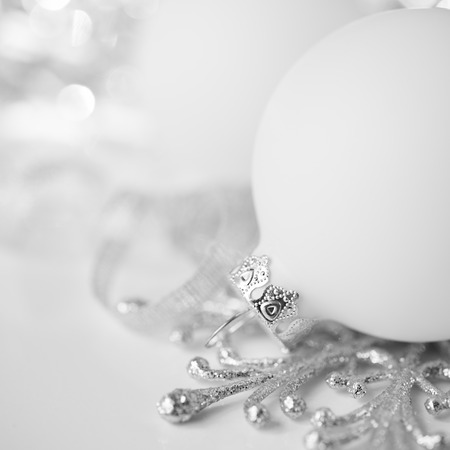 Silver and white christmas decoration on holiday background. Merry xmas card.