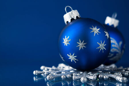 Blue and silver christmas ornaments on dark blue background with space for text. Xmas theme. photo