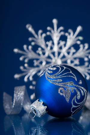 blue and silver christmas ornaments on dark blue xmas background with space for text stock photo - Blue And Silver Christmas Ornaments