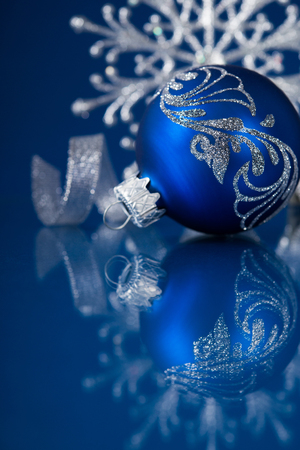 blue and silver christmas ornaments on dark blue xmas background stock photo picture and royalty free image image 33510241 - Navy Blue Christmas Ornaments