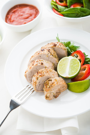 Pork with vegetables and lime on the white. Foto de archivo