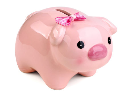 Funny female piggy bank wearing pink bow isolated over white background. Money saving, home bookkeeping, shopping and income concept