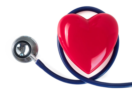 Red toy heart and stethoscope on white background. Healthcare, medical, cardiology and prevention of cardiovascular diseases concept. Stock Photo