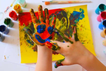 Child painting by finger hand. Ideas for drawing with finger paints. Children development. The concept of a happy childhood and children's day.