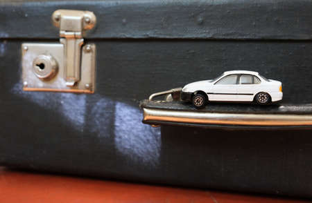 Vintage suitcase and car toy, nostalgic, travel and adventure concept