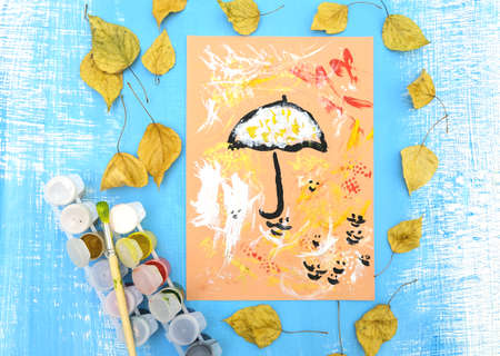 Autumnal card. Child paint umbrella and abstract autumn park use sponge and paintbrush, crafts for kids.