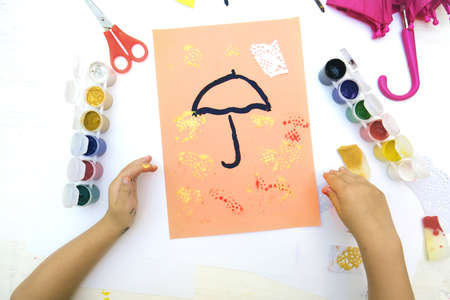 Autumnal card. Child paint umbrella and autumn park use sponge and paintbrush, crafts for kids.