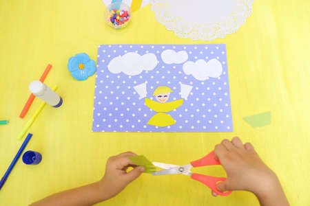 Child making card with funny cows and smiling child with glasses of milk, Creative play with craft. The healthy food theme development of children. School education handmade creativity.