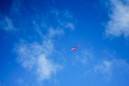Helicopter in a blue sky.air transport. Stock Photo