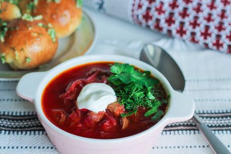 Traditional Ukrainian Russian soup, borsch with garlic donuts, pampushki on a white background Stock Photo