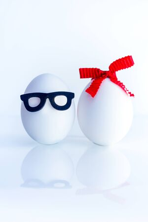 two eggs of male and female appearance on a white background 스톡 콘텐츠