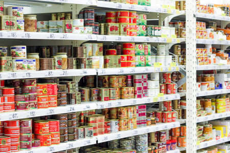 stew and canned food on the shelves of grocery stores. purchasing products before the crisis. Shopping in a supermarket