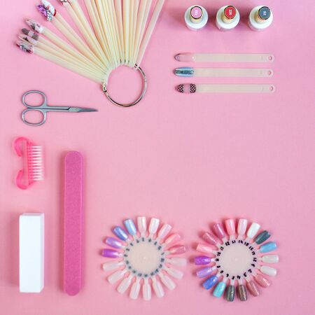 Nail care. set of professional manicure tools. Top view of manicure and pedicure equipment on pink background. Manicure concept. Top view, flat lay. copyspace for your text.