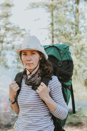 the girl goes on a hike with a large special backpack. outdoor recreation in a camping and tent.