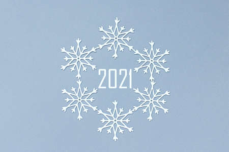 white decorative snowflakes on a gray background. Christmas and New Year, a place for text