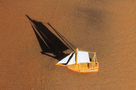model of a sailing ship made of wood, paper on the shore. children's toys, Hobbies.