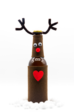 Merry Christmas / Rudolph Red Nose Reindeer in the Snow / Funny Bottle / Christmas Card Stock Photo