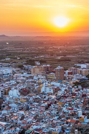 View over the rooftops of Cullera at sunset, Spain