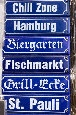 Various signs Hamburg, beer garden, fish market, St. Pauli, Germany