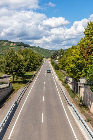 Car on the B53 through Wintrich on the Mosel, Bernkastel-Kues, Rhineland-Palatinate, Germany Фото со стока