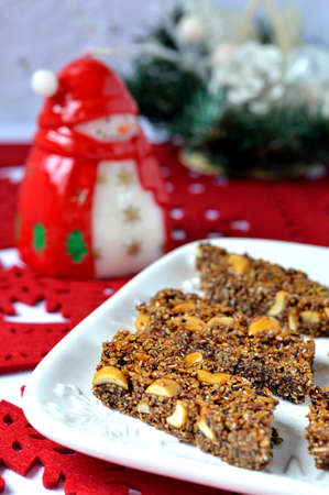 Sweets Southern Italy  Homemade Italian Christmas sweets with sesame seeds and almonds on white dish  Dolci tipici calabresi  photo