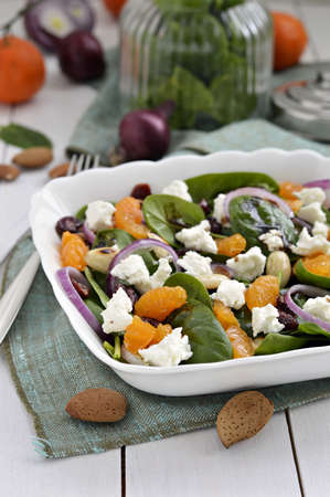 'baby spinach': Baby spinach salad with tangerines, almonds, dried cranberries and feta cheese