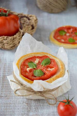Tomato tart with fresh marjoram and garlic  Close-up  photo