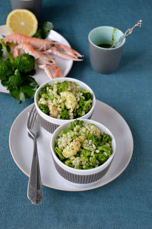 Broccoli salad with pearl barley and Norway lobster Shrimp scampi   photo