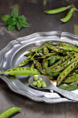Grilled green peas with fresh mint and balsamic vinegar  photo