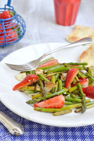 Strawberries and asparagus salad with parmesan cheese, balsamic vinegar and poppy seeds  photo
