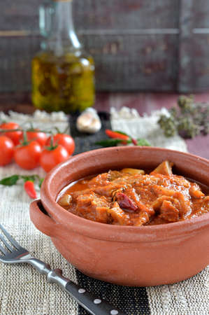 trippa: Tripe soup with tomatoes, spicy chili, basil, oregano in in a ceramic bowl  Italian food, South Italy