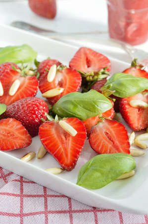 Strawberry salad with basil and pine nuts  photo