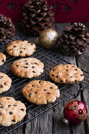 Chocolate Chip Cookies on a metal stand for baking at Christmas Time photo