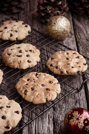 home baked: Home baked chocolate cookies on cooling rack at Christmas time Stock Photo