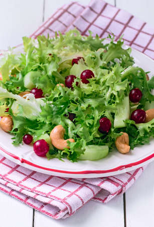 escarole: Fresh Frisee Salad with Red Currants and Cashews