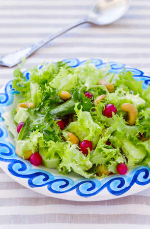 Fresh Frisee  Salad with Red Currants and Cashews Stock Photo