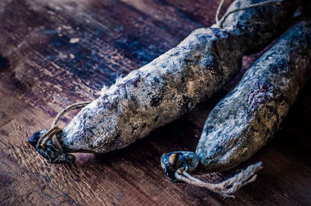 fermenting: Homemade Salami, Sausage, Food. Dark style food styling Stock Photo