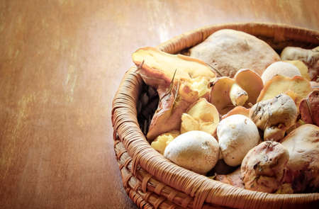 fungaceous: Mushrooms in a basket on wooden surface, Backgrounds, Horizontal