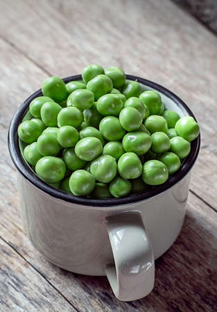 green peas on a wooden background