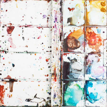 bright ideas: Stains watercolor paints on a palette. It can be used as an original background, space for text. The concept of creativity, drawing education, bright ideas, etc. Stock Photo