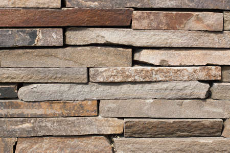 hearth and home: The texture of the gray stonework. The wall built of rectangular stones. Space for text. The concept of reliability, construction, good home, hearth