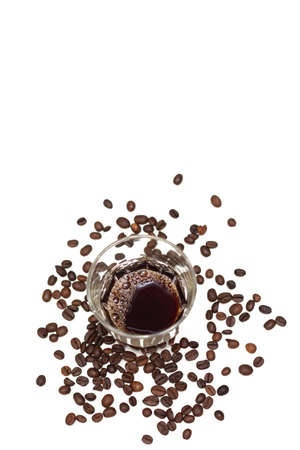 excellent background: Glass with dark coffee and coffee beans isolated on the white background. Excellent background and place for text on topics related to coffee Stock Photo