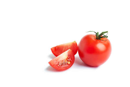 cherry tomato in a cut isolated on a white background. The concept of healthy nutrition, organic food, fresh vegetables, veganism