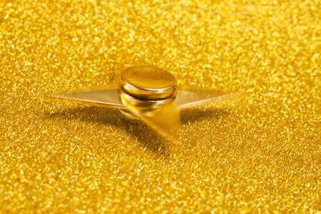 Golden spinner on a sparkling background