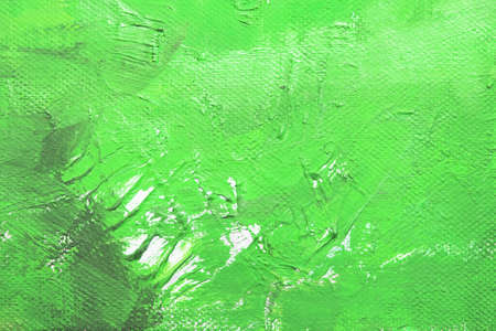 Canvas with oil paints green colors. Bright saturated abstract background, space for text. The concept of a creative atmosphere, artistic events, education, etc.