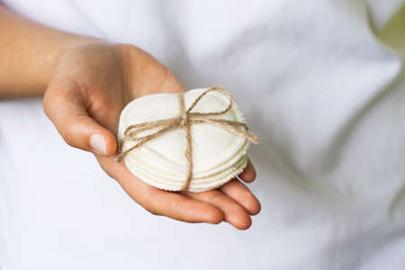 Reusable cotton pads in the womans hand