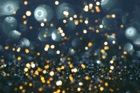 Blue and gold festive background with sparkles in the bokeh. The concept of the celebration, the day of St. Valentine, New Year, birthdays, ceremonies, events, etc.